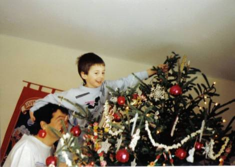 Conor, placing the star atop the tree, at the height of the Tinkerbell bottle days.