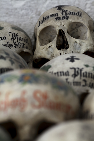 Painted skulls like these, found in the charnel house in Hallstatt, Austria, were once common in small rural parishes in throughout Austria, Switzerland, and Bavaria. (Photo with permission of Paul Koudounaris)